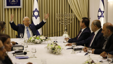 Israeli President Reuven Rivlin, left, speaks with members of the Joint List Ayman Odeh, third right, and Ahmad Tibi, second right, and Mansour Abbas in Jerusalem.