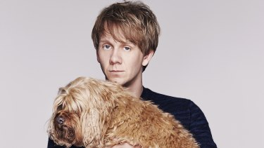 Josh Thomas with his beloved cavoodle, John, who is now too old to travel.
