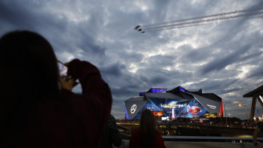 Jets perform a flyover before the Super Bowl in Atlanta.