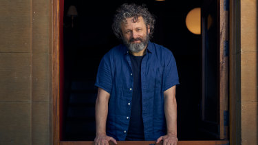 Michael Sheen at his Cardiff home; sketchy wi-fi explains why he's only seen in one setting.