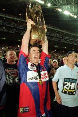Andrew Johns holding aloft the 2001 premiership trophy is one of several enduring images of the great halfback.