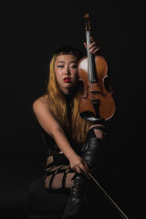 Elle Shimada, violinist, performs the work of Mary Kiernan in <i>The Unforgetting of Mary K</i>.