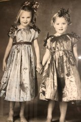 Tamsin (at right, aged 4) with her older sister, Tess.