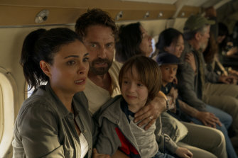 Morena Baccarin, Gerard Butler and Roger Dale Floyd in a scene from the Amazon Prime film Greenland.