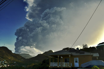 Ash rises into the air as La Soufriere volcano erupts on the eastern Caribbean island of St Vincent on Tuesday.