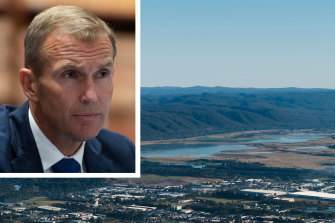 NSW Planning Minister Rob Stokes and an aerial photograph of Penrith, Cranebrook and the Nepean River on the city's western fringe.