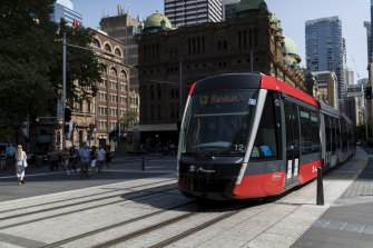 A tram moves down George Street on Monday.
