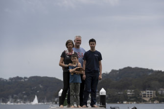 Guy and Zoe Eilbeck at their Scotland Island home with their children Cameron, 13, and Max ,8.