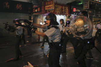Hong Kong police drew weapons and rolled out water cannon trucks for the first time on Sunday night.