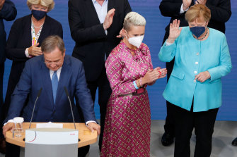 Angela Merkel is given a round of applause at the election night party.