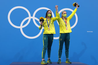 Kaylee McKeown and Emily Seebohm on the top of the medal dias after McKeown won gold in the 200m backstroke.