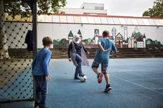 Noura Baterdouk, a 38-year-old mother of three from Syria, plays soccer with two of her sons in Tettnang, Germany.