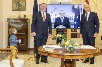 Re-elected Nationals leader Barnaby Joyce's Sebastian runs up as Joyce poses for photos.