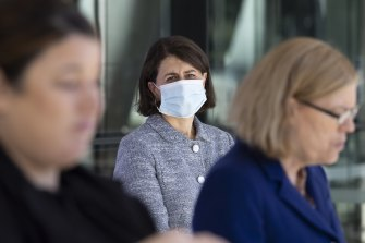 Premier Gladys Berejiklian watches CHO Kerry Chant give a COVID-19 update on Saturday.