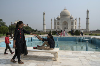 Families at the Taj Mahal in Agra, India, in June. Rather than the typical global mix of travelers, it is now visited mostly by local residents.