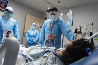 Medical staff wear their photos outside their PPE in COVID ICU at a hospital in Texas.