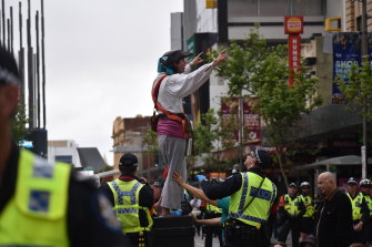 Extinction Rebellion protesters shut down the Hay St intersection in the Perth CBD last year. New research shows environmental activism is having an impact in boardrooms.