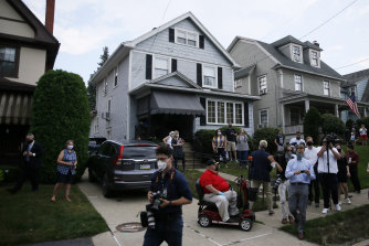 Supporters and media gather outside the childhood home of Democratic presidential candidate Joe Biden during a visit by the former vice-president in July.