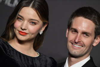 A sad homecoming for model Miranda Kerr and her billionaire husband Evan Spiegel who have quietly flown into Sydney.