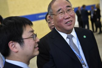 China's Special Envoy on Climate Change Xie Zhenhua, right, in Paris.
