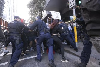 Protesters clash with police in Sydney last Saturday.