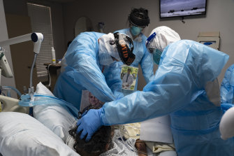 Medical staff treat a COVID-19 patient in the intensive care unit of a hospital in Houston, Texas last month.