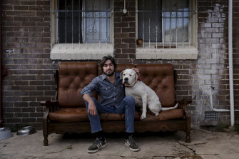 Matt Donn with his dog Tank at their Marrickville home.