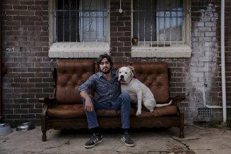 Matt Donn with his dog Tank at their Marrickvillehome.