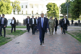 Trump walks to St John's Episcopal Church from the White House.