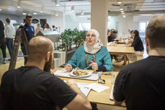 Noura Baterdouk, a 38-year-old mother of three from Syria, during lunch at Vaude in Tettnang, Germany.