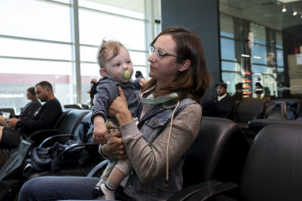 Nina Lacy and her eight-month-old son, Luca, have flown to meet her husband's family in Adelaide.