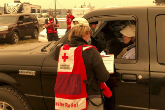 A Red Cross worker takes details from evacuees in Salem, Oregon.