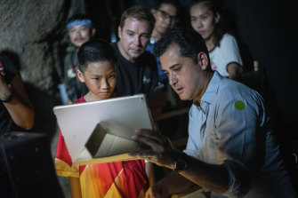 Director Tom Waller, right, talks to actors for a scene of his film The Cave in Thailand.