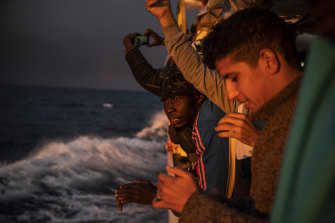 Nigeria and Morocco watch the sunset aboard the Open Arms rescue vessel in the Mediterranean Sea in January. Malta says it can no longer allow migrants to enter.