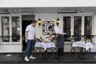 Chef Callum Brewin and waiter Gaetan Dossal are preparing the MacLeay Street Bistro in Potts Point ahead of eased lockdown restrictions.