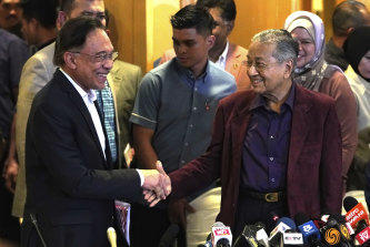 """Anwar Ibrahim and Mahathir Mohamad in  Putrajaya, Malaysia on Saturday. Anwar said he wants Mahathir to be given space to run the country """"without pressure""""."""