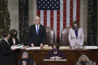 Vice-President Mike Pence is pictured with Speaker of the House Nancy Pelosi just prior to being ushered out of the chamber on January 6.
