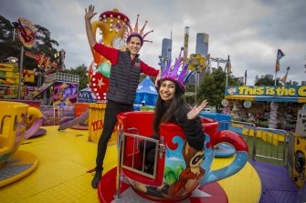 Moomba monarchs Pravini Fernando and Drew Law try out a teacup ride.