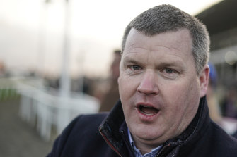 Trainer Gordon Elliott has been banned after a photo surfaced showing him sitting on top of a dead horse.