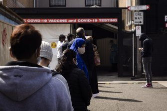 People wait for COVID-19 tests at a walk-in clinic in Lakemba on 28 August, 2021.