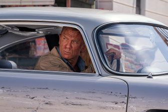Daniel Craig driving on location in the southern Italian city of Matera.