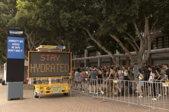 Children arrive for the Lost City music festival at the Sydney Showgrounds on Saturday.