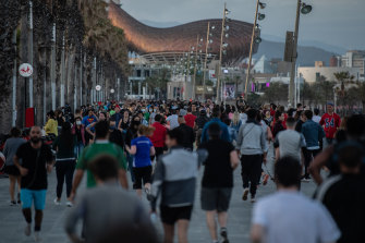 People filling the street in Barcelona on Saturday, able to exercise for the first time in months.