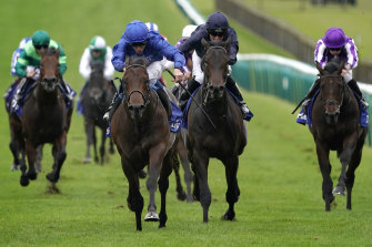 Pinatubo (in blue) wins the Dewhurst Stakes at Newmarket on Saturday.
