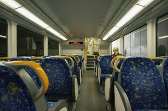 A lone passenger travels on a train in the CBD in April.