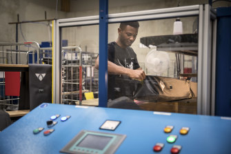 Abdoulie Barry, a 37-year-old from Gambia whose asylum claim was rejected, working at Vaude in Tettnang, Germany. Barry has appealed his rejection.