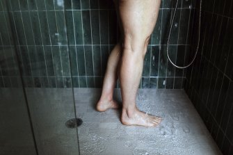 A woman showers in Edgartown, Massachusetts on the island of Martha's Vineyard. Some people have said they started bathing less during the pandemic.