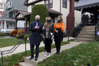 Democratic presidential candidate former Vice President Joe Biden speaks to reporters after he visited his childhood home in Scranton with his granddaughters Natalie, centre, and Finnegan.