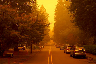 A street in West Linn, Oregon, is shrouded in smoke from wildfires.