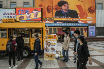 A McDonald's ice cream truck outside a vaccination centre in Beijing on Tuesday, offers a two-for-one promotion for those getting a COVID-19 vaccine.